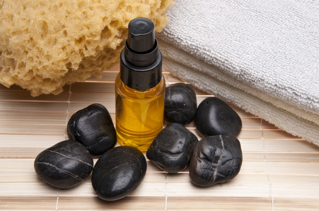 hot stones and essential oils for massage therapy