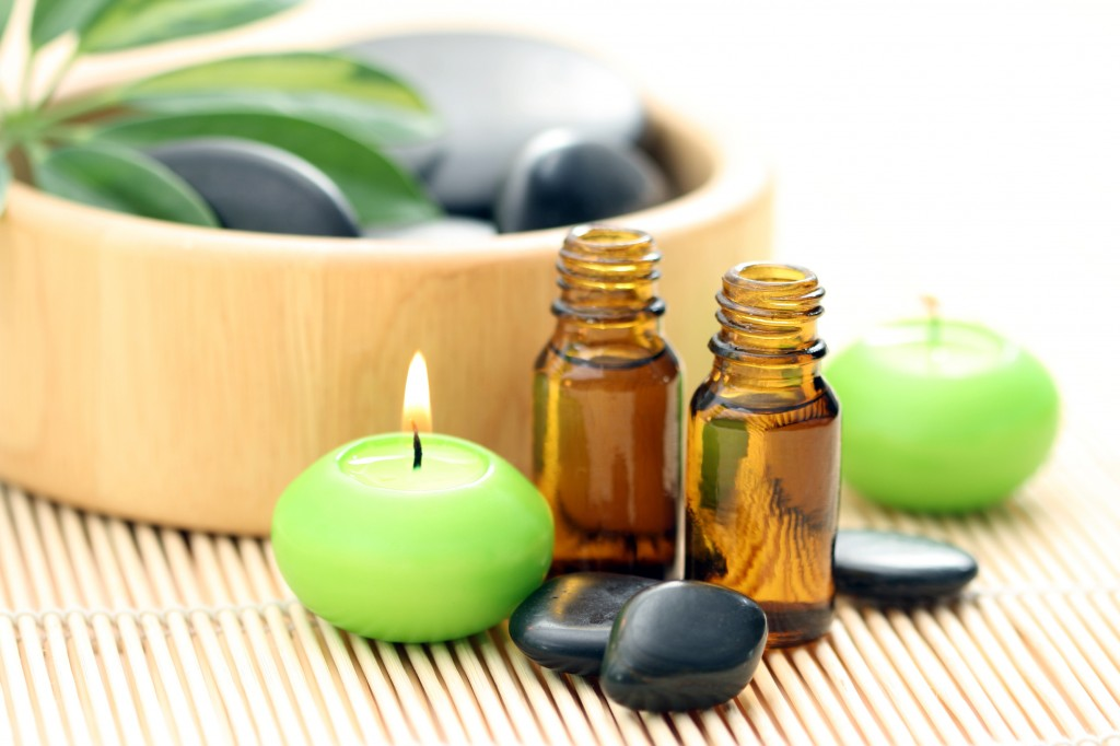 Massage oil and hot stones for therapeutic massage