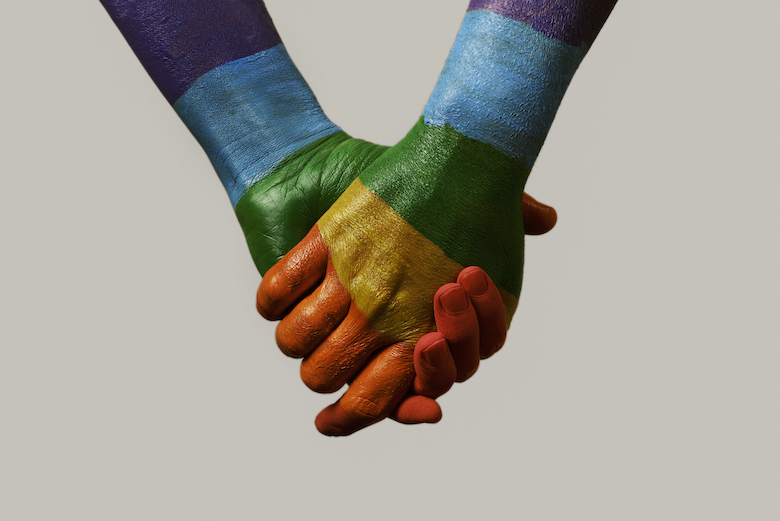 hands-patterned-with-the-rainbow-flag